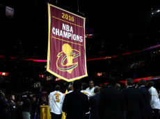 CLEVELAND, OH - OCTOBER 25:  The Cleveland Cavaliers championship banner is raised before the game against the New York Knicks at Quicken Loans Arena on October 25, 2016 in Cleveland, Ohio.  NOTE TO USER: User expressly acknowledges and agrees that, by downloading and or using this photograph, User is consenting to the terms and conditions of the Getty Images License Agreement. (Photo by Ezra Shaw/Getty Images)