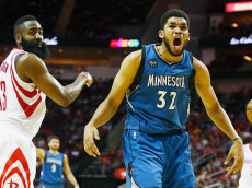 HOUSTON, TX - MARCH 18:  Karl-Anthony Towns #32 of the Minnesota Timberwolves reacts to a call in front of James Harden #13 of the Houston Rockets on the court during their game at the Toyota Center on March 18, 2016 in Houston, Texas.  NOTE TO USER: User expressly acknowledges and agrees that, by downloading and or using this Photograph, user is consenting to the terms and conditions of the Getty Images License Agreement.  (Photo by Scott Halleran/Getty Images)