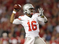 MADISON, WI - OCTOBER 15: J.T. Barrett #16 of the Ohio State Buckeyes drops back to pass the football during there second quarter during the game against the Wisconsin Badgers at Camp Randall Stadium on October 15, 2016 in Madison, Wisconsin. (Photo by Mike McGinnis/Getty Images)  *** Local Caption *** J.T. Barrett