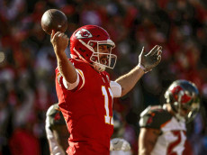 KANSAS CITY, MO - NOVEMBER 20: Quarterback Alex Smith #11 of the Kansas City Chiefs throws his hands up in celebration after scoring the games first touchdown against the Tampa Bay Buccaneers at Arrowhead Stadium during the second quarter of the game on November 20, 2016 in Kansas City, Missouri. (Photo by Jamie Squire/Getty Images)