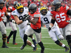COLUMBUS, OH - NOVEMBER 26:   Curtis Samuel #4 of the Ohio State Buckeyes rushes for the game-winning touchdown in overtime against the Michigan Wolverines at Ohio Stadium on November 26, 2016 in Columbus, Ohio.  (Photo by Jamie Sabau/Getty Images)
