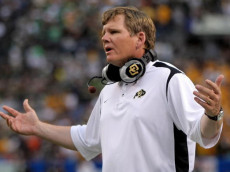 DENVER - AUGUST 31:  Head coach Dan Hawkins of the University of Colorado Buffaloes protests a call to the officials against the Colorado State University Rams at Invesco Field at Mile High on August 31, 2008 in Denver, Colorado.  (Photo by Doug Pensinger/Getty Images)