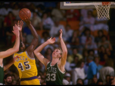 Undated:  Forward Larry Bird of the Boston Celtics prepares to block an the shot of forward A.C. Green of the Los Angeles Lakers during the Celtics game versus the Celtics at the Forum in Inglewood, California. Mandatory Credit: Rick Stewart  /Allsport
