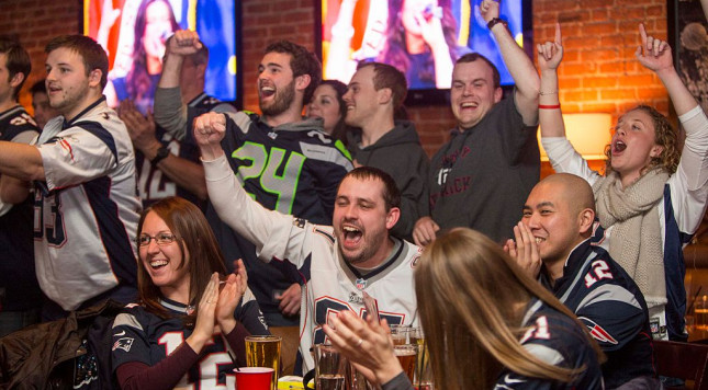 BOSTON, MA - FEBRUARY 1:  New England Patriots fans celebrate during the opening ceremony of Super Bowl XLIX at Jerry Remy's Sports Bar February 1, 2015 in Boston, Massachusetts. The Patriots and Seattle Seahawks square off in this year's matchup.  (Photo by Scott Eisen/Getty Images)