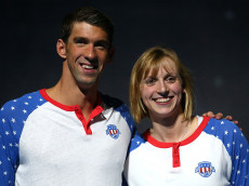 OMAHA, NE - JULY 03:  (L-R) Michael Phelps and Katie Ledecky of the United States celebrate during Day Eight of the 2016 U.S. Olympic Team Swimming Trials at CenturyLink Center on July 3, 2016 in Omaha, Nebraska.  (Photo by Tom Pennington/Getty Images)