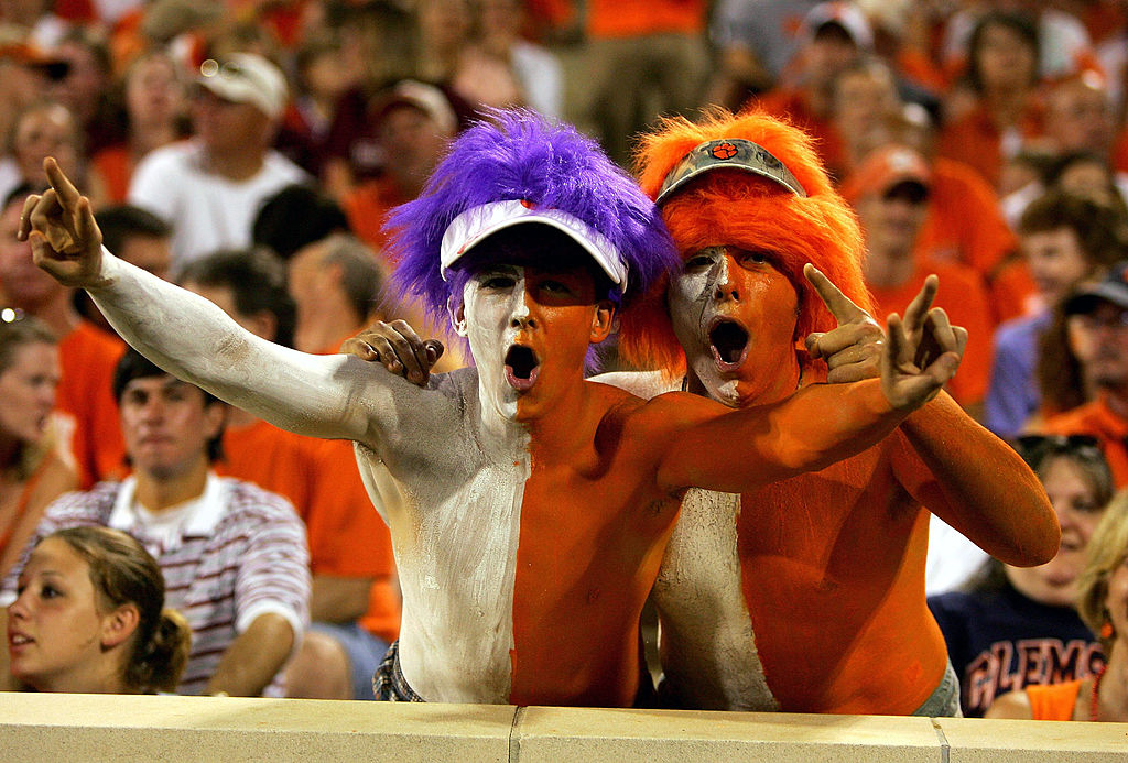 CLEMSON, SC - SEPTEMBER 3:  Fans of the Clemson Tigers cheer during the game against the Texas A&M Aggies at Clemson Memorial Stadium on September 3, 2005 in Clemson, South Carolina. Clemson defeated Texas A&M 25-24.  (Photo by Streeter Lecka/Getty Images)