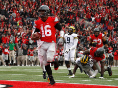 COLUMBUS, OH - NOVEMBER 26:   J.T. Barrett #16 of the Ohio State Buckeyes rushes for a touchdown in overtime against the Michigan Wolverines at Ohio Stadium on November 26, 2016 in Columbus, Ohio.  (Photo by Gregory Shamus/Getty Images)