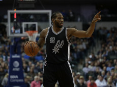 DALLAS, TX - NOVEMBER 30:  Kawhi Leonard #2 of the San Antonio Spurs during play against the Dallas Mavericks at American Airlines Center on November 30, 2016 in Dallas, Texas.  NOTE TO USER: User expressly acknowledges and agrees that , by downloading and or using this photograph, User is consenting to the terms and conditions of the Getty Images License Agreement.  (Photo by Ronald Martinez/Getty Images)
