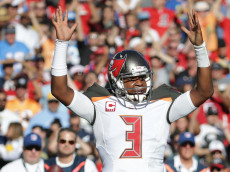 SAN DIEGO, CA - DECEMBER 04:  Quarterback Jameis Winston #3 of the Tampa Bay Buccaneers celebrates a touchdown by teammate Doug Martin in the first quarter at Qualcomm Stadium on December 4, 2016 in San Diego, California. The Buccaneers defeated the Chargers 28-21.  (Photo by Jeff Gross/Getty Images)