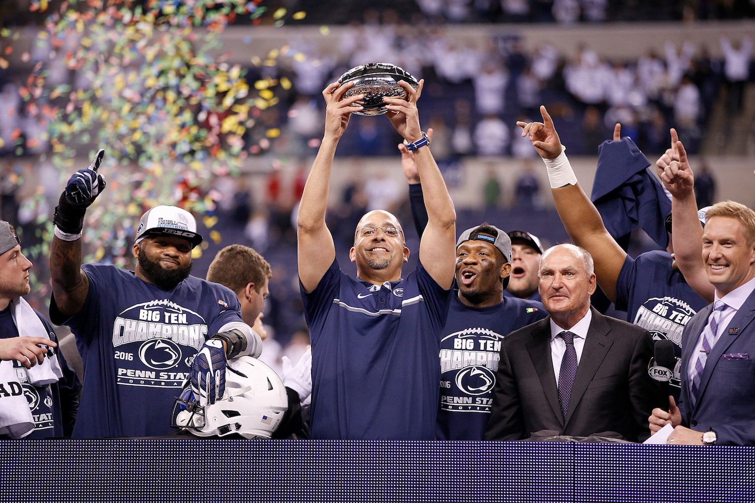INDIANAPOLIS, IN - DECEMBER 03: James Franklin, head coach of the Penn State Nittany Lions, celebrates with the Big Ten Championship trophy after Penn State beat the Wisconsin Badgers 38-31 at Lucas Oil Stadium on December 3, 2016 in Indianapolis, Indiana.  (Photo by Joe Robbins/Getty Images)