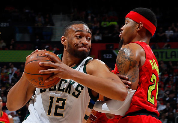 ATLANTA, GA - JANUARY 15:  Kent Bazemore #24 of the Atlanta Hawks draws a charge from Jabari Parker #12 of the Milwaukee Bucks at Philips Arena on January 15, 2017 in Atlanta, Georgia.  NOTE TO USER User expressly acknowledges and agrees that, by downloading and or using this photograph, user is consenting to the terms and conditions of the Getty Images License Agreement.  (Photo by Kevin C. Cox/Getty Images)