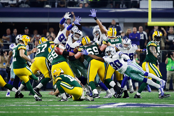 ARLINGTON, TX - JANUARY 15:  Mason Crosby #2 of the Green Bay Packers kicks a field goal to beat the Dallas Cowboys 34-31 in the NFC Divisional Playoff Game at AT&T Stadium on January 15, 2017 in Arlington, Texas.  (Photo by Joe Robbins/Getty Images)