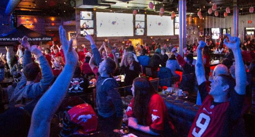 Canadian bars, like this one showing the 2014 Grey Cup, may have a tougher time airing sports in future.