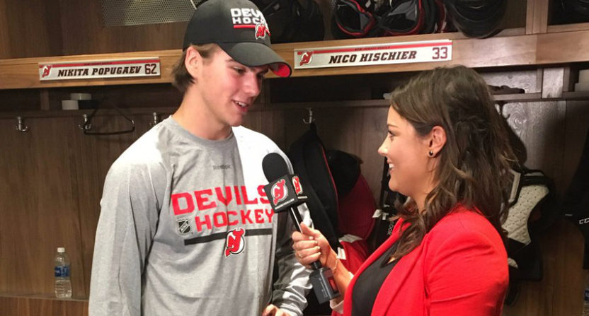 Amanda Stein interviews Nico Hischier during Devils' prospect camp.