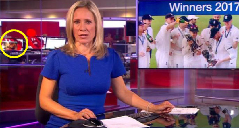 A monitor on-screen in the BBC newsroom showed a woman taking off her top.