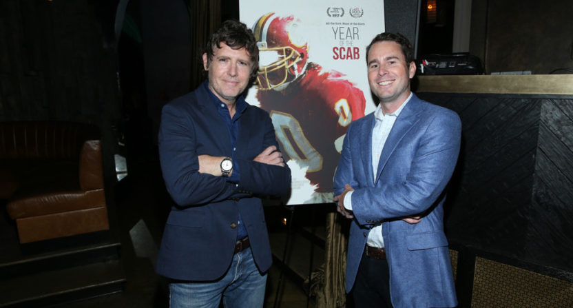 Year of the Scab premiered at the Tribeca Film Festival this year. Director John Dorsey (L) and executive producer David George are seen with the poster.
