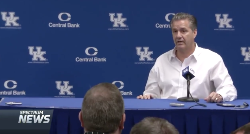 Reporter checks Kentucky Wildcats' John Calipari during FBI investigation question