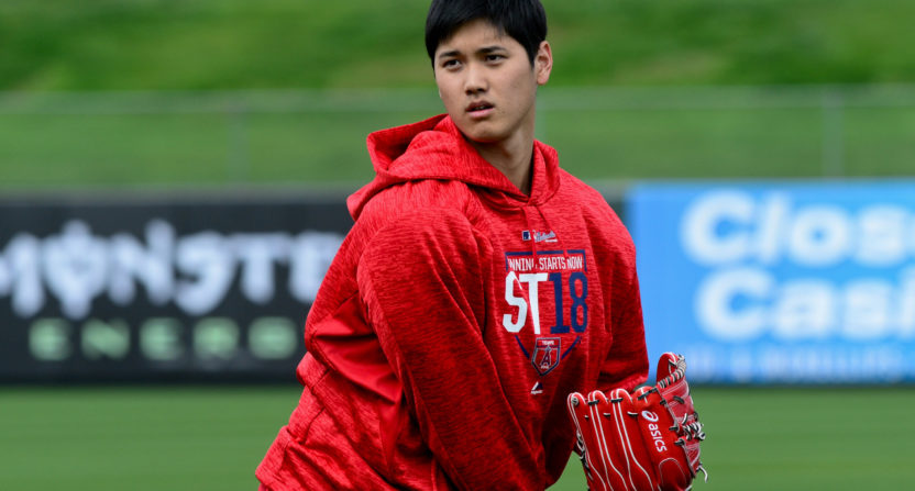 Ohtani reports to Angels with physical, swings and long toss