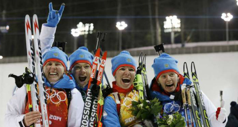 (L to R) Yana Romanova, Olga Zaytseva, Ekaterina Shumilova and Olga Vilukhina after winning silver at the Sochi Olympics team biathlon event. All but Shumilova have since been banned by the IOC over doping, and Russia was stripped of the silver medal.