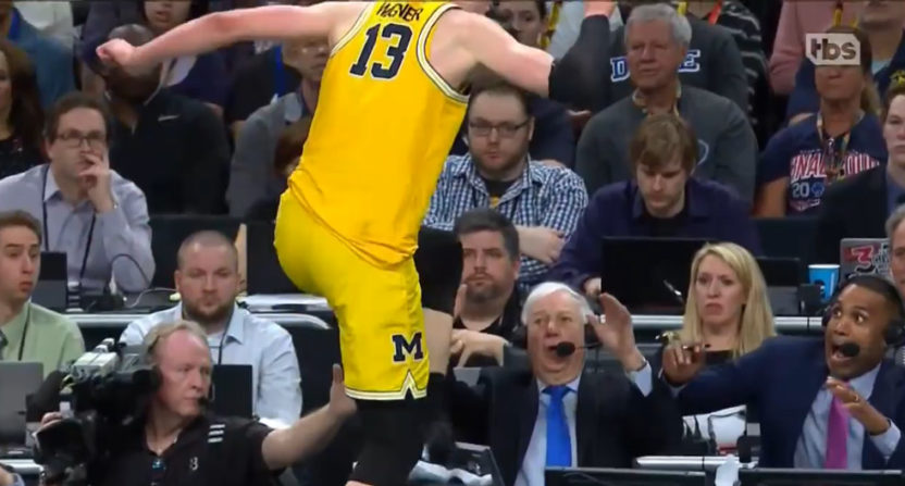 Moritz Wagner leaps onto the TBS announcing table in front of Bill Raftery and Grant Hill.