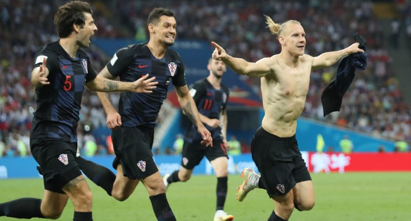 Croatia celebrating a World Cup win against Russia.