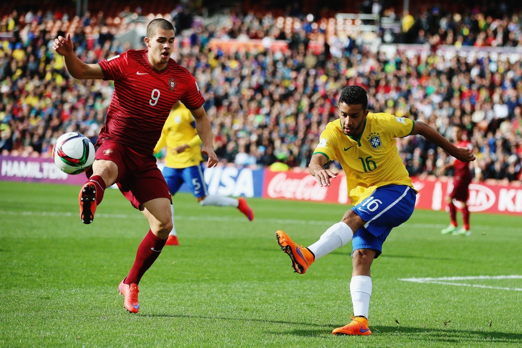 HAMILTON, NEW ZEALAND - JUNE 14: Jorge of Brazil kicks the ball past Andre Silva of Portugal during the FIFA U-20 World Cup New Zealand 2015 quarter final match between Brazil and Portugal held at Waikato Stadium on June 14, 2015 in Hamilton, New Zealand.  (Photo by Hannah Peters/Getty Images)