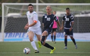 Matao captain Jason Cunliffe sends a pass to a teammate ahead of Turkmenistan's Atayev Ahmet during Guam's first-ever FIFA World Cup Qualifier match held in Guam Thursday afternoon. (courtesy Guam Football Association)