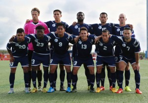 Guam's starting eleven players pose for a photo before the team's opening match of its 2018 FIFA World Cup Qualifier bid at the Guam Football Association National Training Center. (courtesy of Guam Football Association)