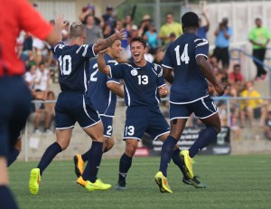 Guam's Ryan Guy enthusiastically celebrates with teammates after his throw-in against Turkmenistan that resulted in the lone goal of the contest during Guam's first-ever FIFA World Cup Qualifier match held in Guam Thursday afternoon. (courtesy Guam Football Association)