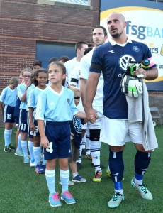 FC goalie Gregory Hartley prepares to lead the team and their young counterparts onto the field. Chattanooga FC hosted the Miami Fusion in soccer playoff action at Finley Stadium Saturday night, July 18, 2015 Photo by Robin Rudd /Times Free Press.