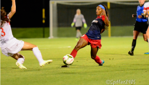 Crystal Dunn dribbles past a Western New York Flash defender. Photo by Washington Spirit.