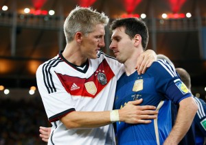RIO DE JANEIRO, BRAZIL - JULY 13:  Bastian Schweinsteiger of Germany hugs Lionel Messi of Argentina after Germany's 1-0 victory  in extra time during the 2014 FIFA World Cup Brazil Final match between Germany and Argentina at Maracana on July 13, 2014 in Rio de Janeiro, Brazil.  (Photo by Clive Rose/Getty Images)