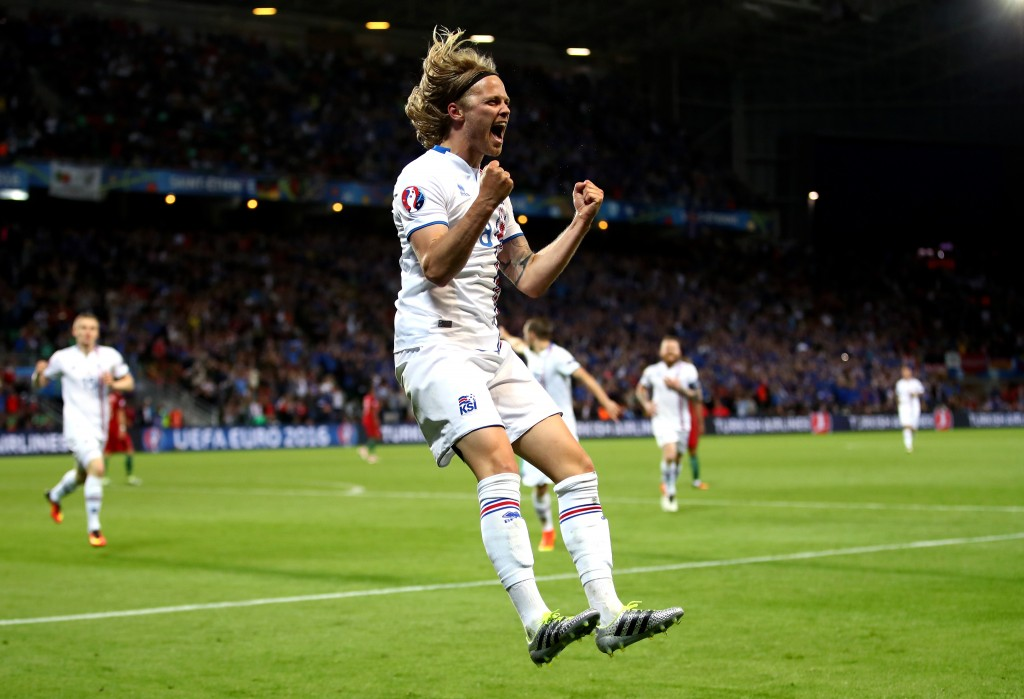 SAINT-ETIENNE, FRANCE - JUNE 14:  Birkir Bjarnason of Iceland celebrates scoring his team's first goal during the UEFA EURO 2016 Group F match between Portugal and Iceland at Stade Geoffroy-Guichard on June 14, 2016 in Saint-Etienne, France.  (Photo by Clive Brunskill/Getty Images)