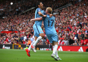 MANCHESTER, ENGLAND - SEPTEMBER 10: Kevin De Bruyne of Manchester City celebrates scoring his sides first goal with team mate Nolito of Manchester City during the Premier League match between Manchester United and Manchester City at Old Trafford on September 10, 2016 in Manchester, England.  (Photo by Alex Livesey/Getty Images)