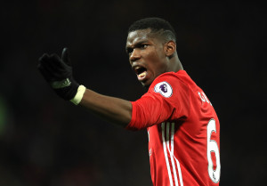 MANCHESTER, ENGLAND - DECEMBER 11:  Paul Pogba of Manchester United gestures  during the Premier League match between Manchester United and Tottenham Hotspur at Old Trafford on December 11, 2016 in Manchester, England.  (Photo by Richard Heathcote/Getty Images)