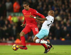 LIVERPOOL, ENGLAND - DECEMBER 11: Joel Matip of Liverpool and Andre Ayew of West Ham United compete for the ball during the Premier League match between Liverpool and West Ham United at Anfield on December 11, 2016 in Liverpool, England.  (Photo by Jan Kruger/Getty Images)