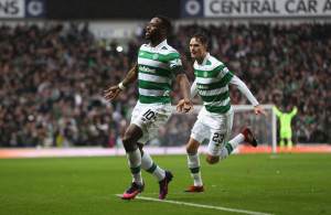 GLASGOW, SCOTLAND - DECEMBER 31:  Moussa Dembele (L) of Celtic celebrates scoring his team's first goal during the Ladbrokes Scottish Premiership match between Rangers and Celtic at Ibrox Stadium on December 31, 2016 in Glasgow, Scotland.  (Photo by Ian MacNicol/Getty Images)