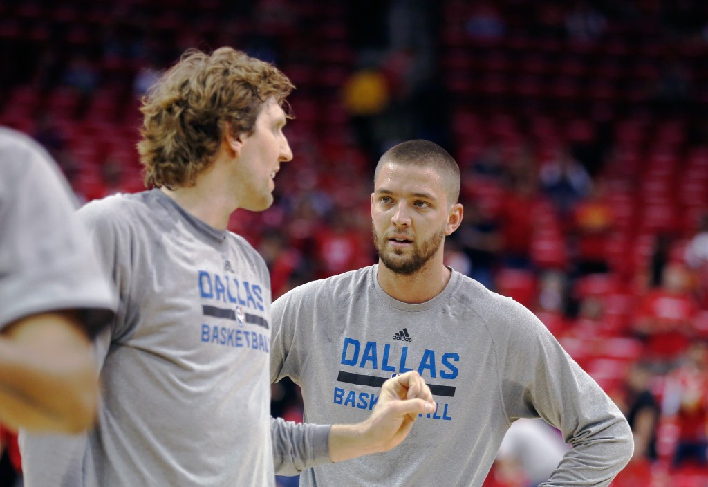 HOUSTON, TX - APRIL 18:  Dirk Nowitzki #41 (L) and Chandler Parsons #25 of the Dallas Mavericks wait on the court prior to the start of the game between the Dallas Mavericks and Houston Rockets during Game One in the Western Conference Quarterfinals of the 2015 NBA Playoffs on April 18, 2015 at the Toyota Center in Houston, Texas. NOTE TO USER: User expressly acknowledges and agrees that, by downloading and/or using this photograph, user is consenting to the terms and conditions of the Getty Images License Agreement.  (Photo by Scott Halleran/Getty Images)