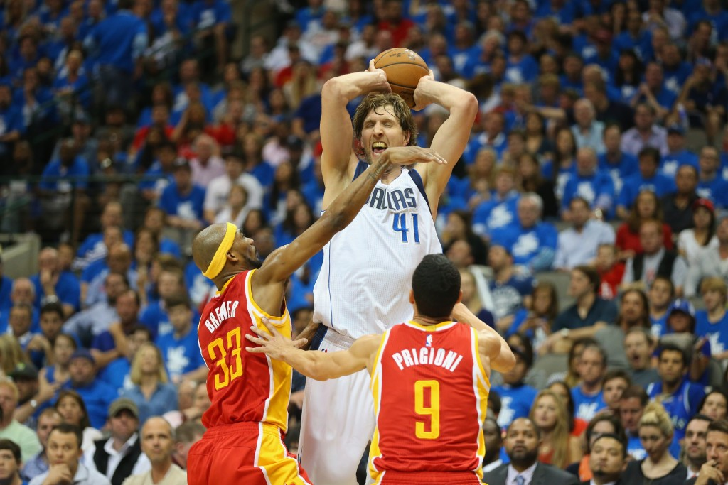 DALLAS, TX - APRIL 26:  Dirk Nowitzki #41 of the Dallas Mavericks takes a shot against Corey Brewer #33 and Pablo Prigioni #9 of the Houston Rockets  during Game Four of the Western Conference quarterfinals of the 2015 NBA Playoffs at American Airlines Center on April 26, 2015 in Dallas, Texas.  NOTE TO USER: User expressly acknowledges and agrees that, by downloading and or using this photograph, User is consenting to the terms and conditions of the Getty Images License Agreement.  (Photo by Ronald Martinez/Getty Images)