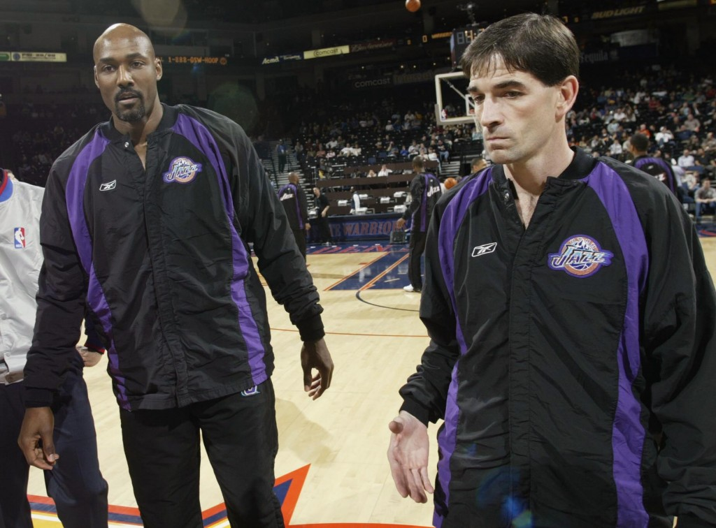 OAKLAND, CA - APRIL 8:  Karl Malone #32 and John Stockton #12 of the Utah Jazz before a game against the Golden State Warriors at the Network Associates Coliseum on April 8, 2003 in Oakland, California. NOTE TO USER: User expressly acknowledges and agrees that, by downloading and/or using this Photograph, User is consenting to the terms and conditions of the Getty Images License Agreement.  (Photo by Jed Jacobsohn/Getty Images)