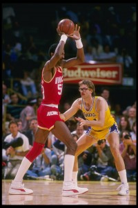 1985:  Center Ralph Sampson of the Houston Rockets tries to keep the ball away from forward Kurt Rambis of the Los Angeles Lakers (right)  during a game at the Great Western Forum in Inglewood, California. Mandatory Credit: Allsport  /Allsport