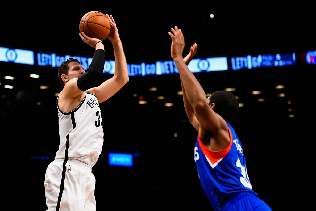 NEW YORK, NY - OCTOBER 20: Mirza Teletovic #33 of the Brooklyn Nets shoots over Hollis Thompson #31 of the Philadelphia 76ers in a preseason game at the Barclays Center on October 20, 2014 in New York City. NOTE TO USER: User expressly acknowledges and agrees that, by downloading and/or using this photograph, user is consenting to the terms and conditions of the Getty Images License Agreement.  (Photo by Alex Goodlett/Getty Images)