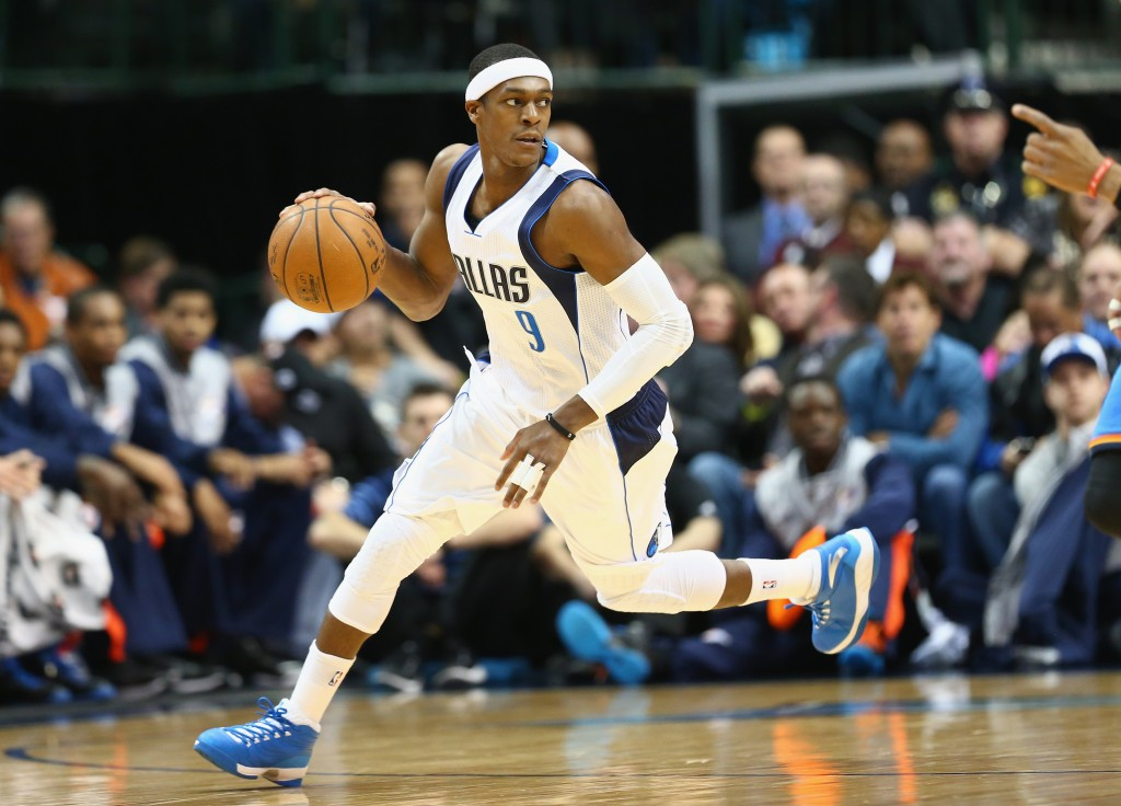 DALLAS, TX - DECEMBER 28:  Rajon Rondo #9 of the Dallas Mavericks dribbles the ball against the Oklahoma City Thunder at American Airlines Center on December 28, 2014 in Dallas, Texas.  NOTE TO USER: User expressly acknowledges and agrees that, by downloading and or using this photograph, User is consenting to the terms and conditions of the Getty Images License Agreement.  (Photo by Ronald Martinez/Getty Images)