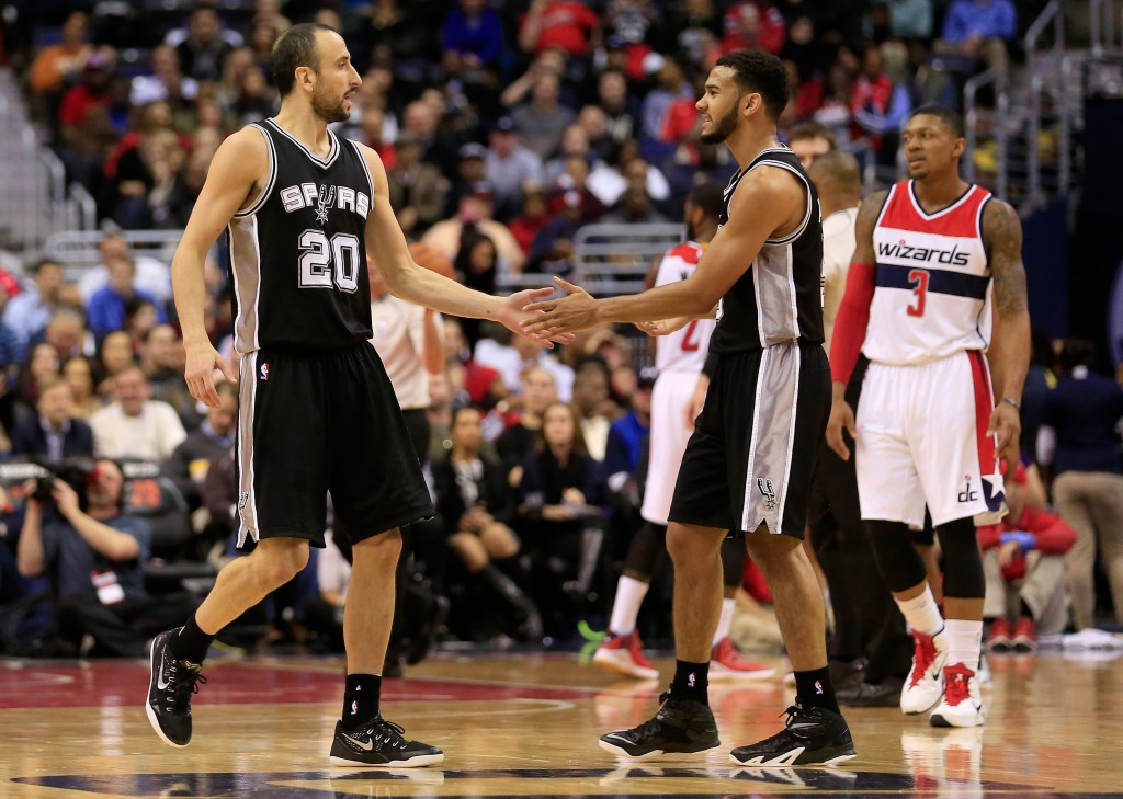 WASHINGTON, DC - JANUARY 13:  Cory Joseph #5 of the San Antonio Spurs celebrates with teammate Manu Ginobili #20 after making a shot against the Washington Wizards during the first half at Verizon Center on January 13, 2015 in Washington, DC. NOTE TO USER: User expressly acknowledges and agrees that, by downloading and or using this photograph, User is consenting to the terms and conditions of the Getty Images License Agreement.  (Photo by Rob Carr/Getty Images)