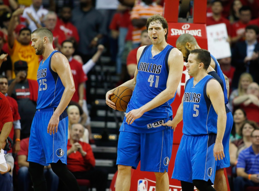 HOUSTON, TX - APRIL 18:  (L-R) Chandler Parsons #25, Dirk Nowitzki #41, J.J. Barea #5 and Tyson Chandler #6 of the Dallas Mavericks react to a play late in the game during Game One in the Western Conference Quarterfinals of the 2015 NBA Playoffs on April 18, 2015 at the Toyota Center in Houston, Texas. NOTE TO USER: User expressly acknowledges and agrees that, by downloading and/or using this photograph, user is consenting to the terms and conditions of the Getty Images License Agreement.  (Photo by Scott Halleran/Getty Images)