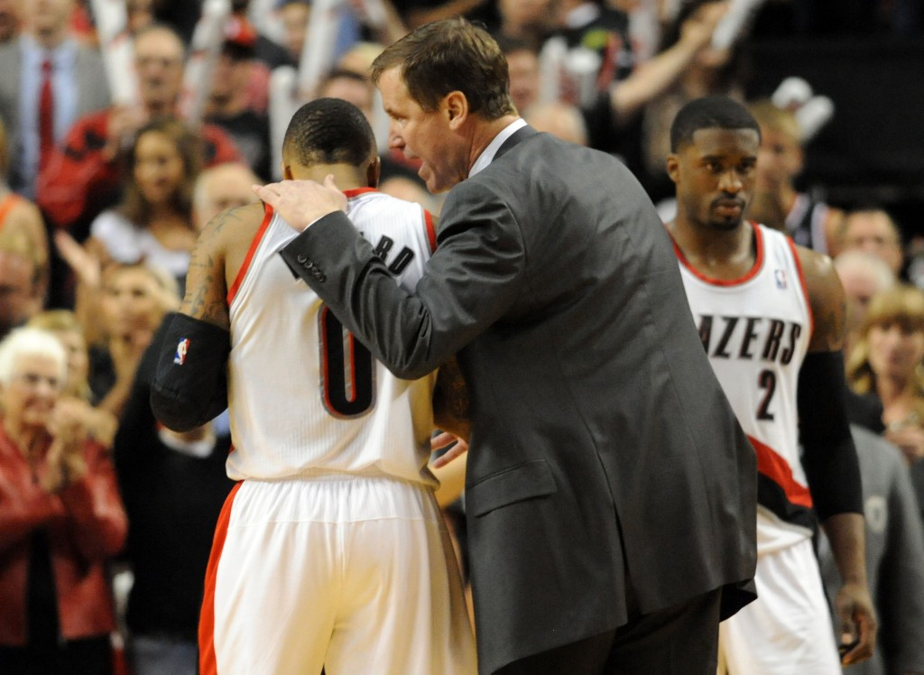 PORTLAND, OR - MAY 2: Terry Stotts of the Portland Trail Blazers has some words with Damian Lillard #0 of the Portland Trail Blazers late in the fourth quarter of Game Six of the Western Conference Quarterfinals against the Houston Rockets during the 2014 NBA Playoffs at the Moda Center on May 2, 2014 in Portland, Oregon. NOTE TO USER: User expressly acknowledges and agrees that, by downloading and or using this photograph, User is consenting to the terms and conditions of the Getty Images License Agreement. (Photo by Steve Dykes/Getty Images)