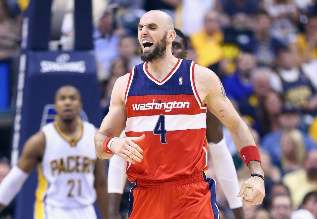 INDIANAPOLIS, IN - MAY 13:  Marcin Gortat #4 of the Washington Wizards celebrates against the   Indiana Pacers in Game 5 of the Eastern Conference Semifinals during the 2014 NBA Playoffs at Bankers Life Fieldhouse on May 13, 2014 in Indianapolis, Indiana. NOTE TO USER: User expressly acknowledges and agrees that, by downloading and or using this photograph, User is consenting to the terms and conditions of the Getty Images License Agreement.  (Photo by Andy Lyons/Getty Images)