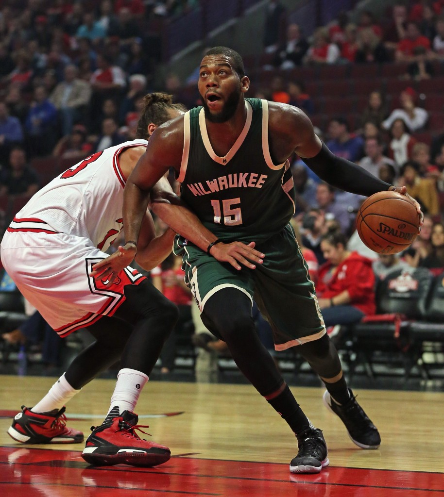 CHICAGO, IL - OCTOBER 06:  Greg Monroe #15 of the Milwaukee Bucks moves around Joakim Noah #13 of the Chicago Bulls during a preseason game at the United Center on October 6, 2015 in Chicago, Illinois. Note to User: User expressly acknowledges and agrees that, by downloading and or using the photograph, User is consenting to the terms and conditiopns of the Getty Images License Agreement.  (Photo by Jonathan Daniel/Getty Images)