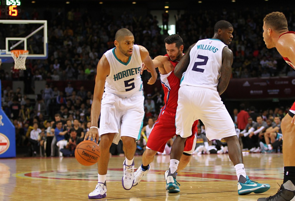 SHENZHEN, CHINA - OCTOBER 11: Nicolas Batum #5 of Charlotte Hornets handles the basketball during the match between Charlotte Hornets and Los Angeles Clippers as part of the 2015 NBA Global Games China at Universiade Centre on October 11, 2015 in Shenzhen, China. (Photo by Zhong Zhi/Getty Images)