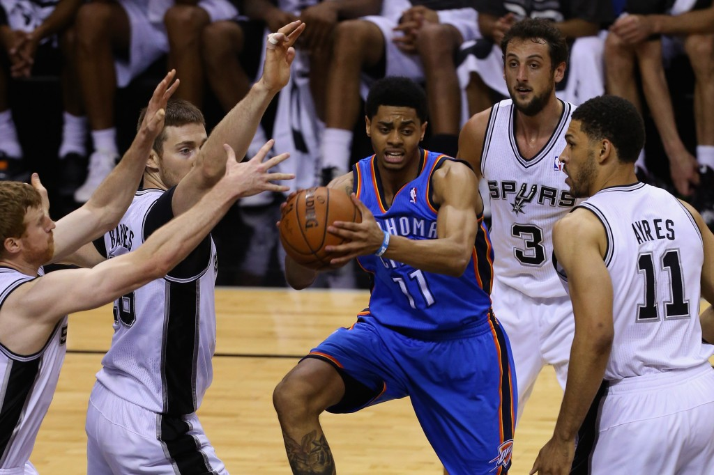 SAN ANTONIO, TX - MAY 29: Jeremy Lamb #11 of the Oklahoma City Thunder looks to pass against Matt Bonner #15, Aron Baynes #16, Marco Belinelli #3 and Jeff Ayres #11 of the San Antonio Spurs in the fourth quarter during Game Five of the Western Conference Finals of the 2014 NBA Playoffs at AT&T Center on May 29, 2014 in San Antonio, Texas. NOTE TO USER: User expressly acknowledges and agrees that, by downloading and or using this photograph, User is consenting to the terms and conditions of the Getty Images License Agreement.  (Photo by Chris Covatta/Getty Images)